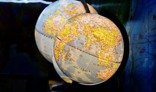 A Global Minimum Tax and Cross-Border Investment: Risks & Solutions
